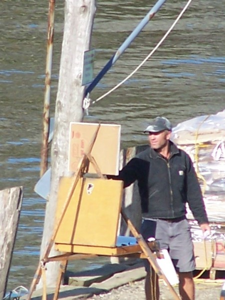 Tim Bell painting on the wharf, Monhegan
