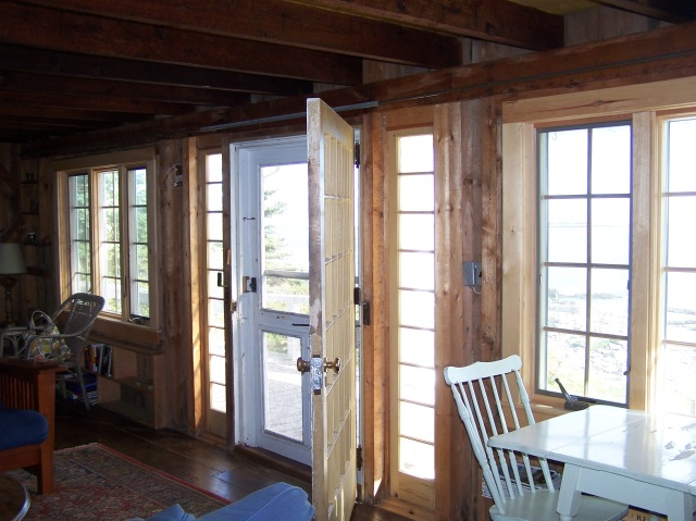 Wide door that goes out onto oceanside porch