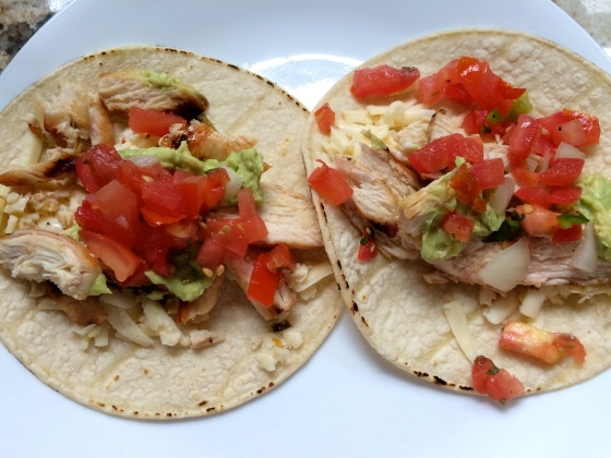 Corn tortillas with chicken, cheese, salsa and guac
