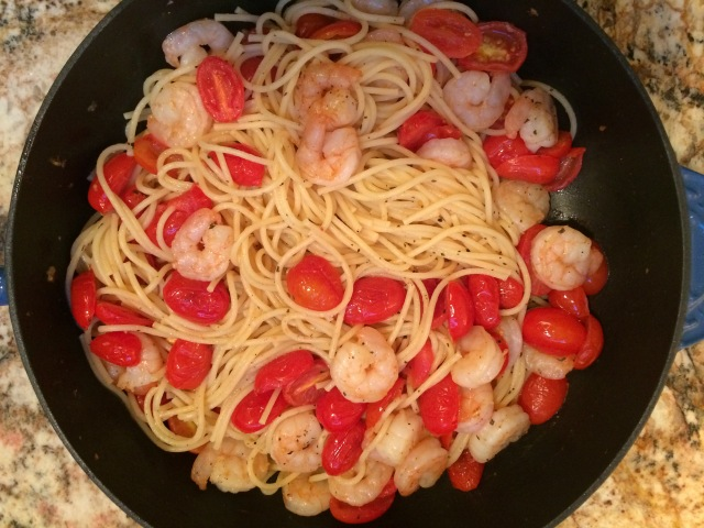 Shrimp and roasted tomatoes with pasta and feta